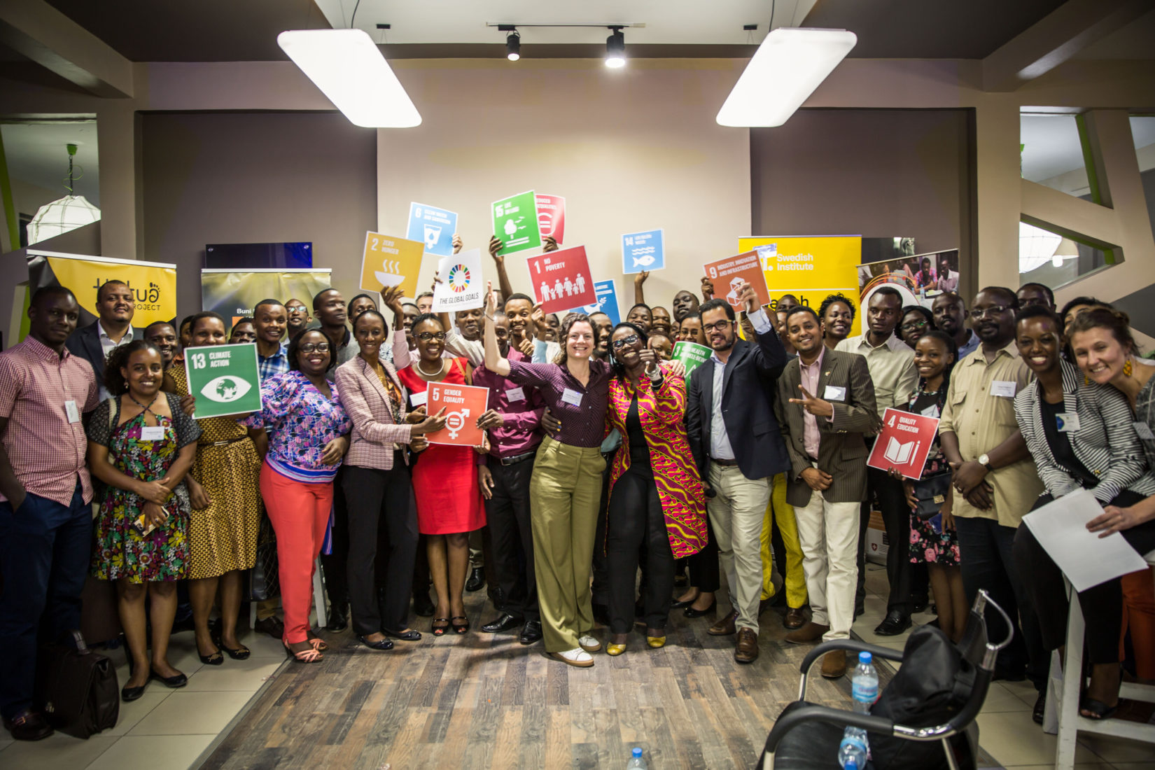 over 30 participants in group picture with symbols of SDGs in their hands