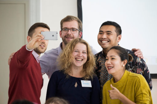 A group of people taking a selfie
