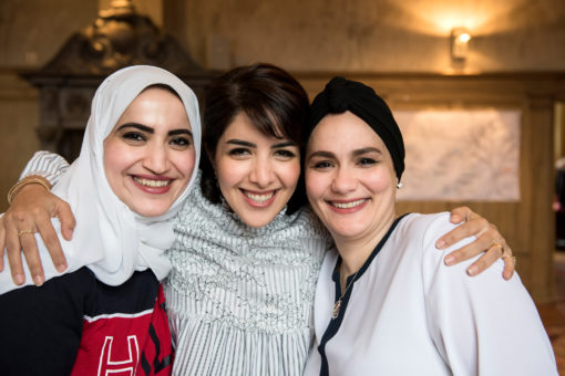 picture of three female participants from Saudi Arabia. They all have a great smile on their face.