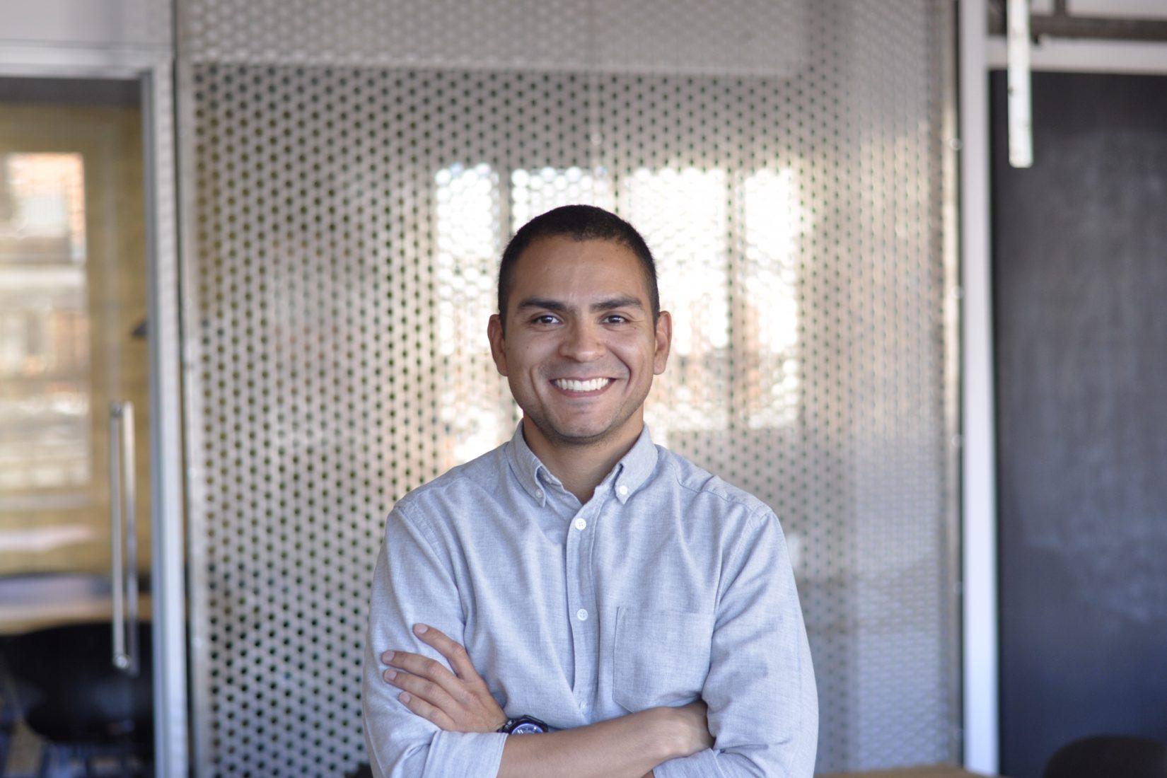 Previous SI scholarship holder Thiago Ferreira in an office