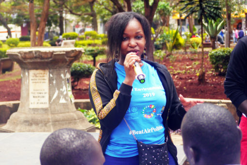 SI scholarship holder, Judith Achieng' Oginga, is talking in front of some persons.