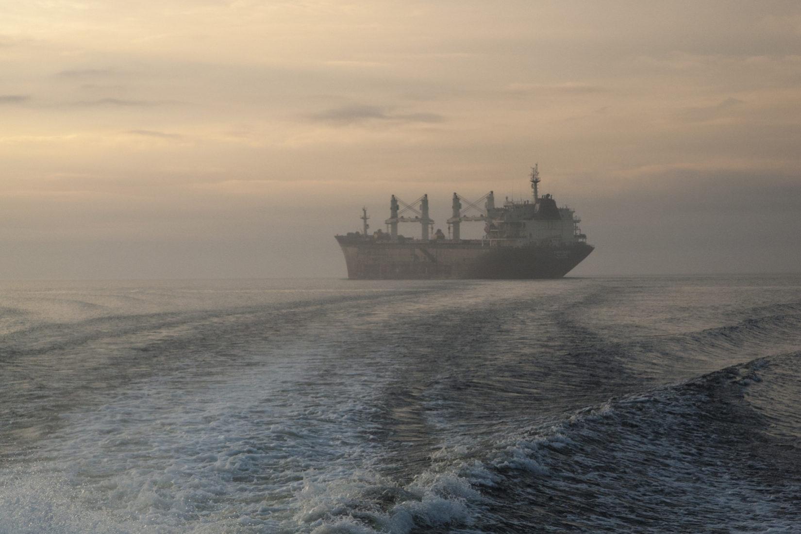 Ship at sea at dawn