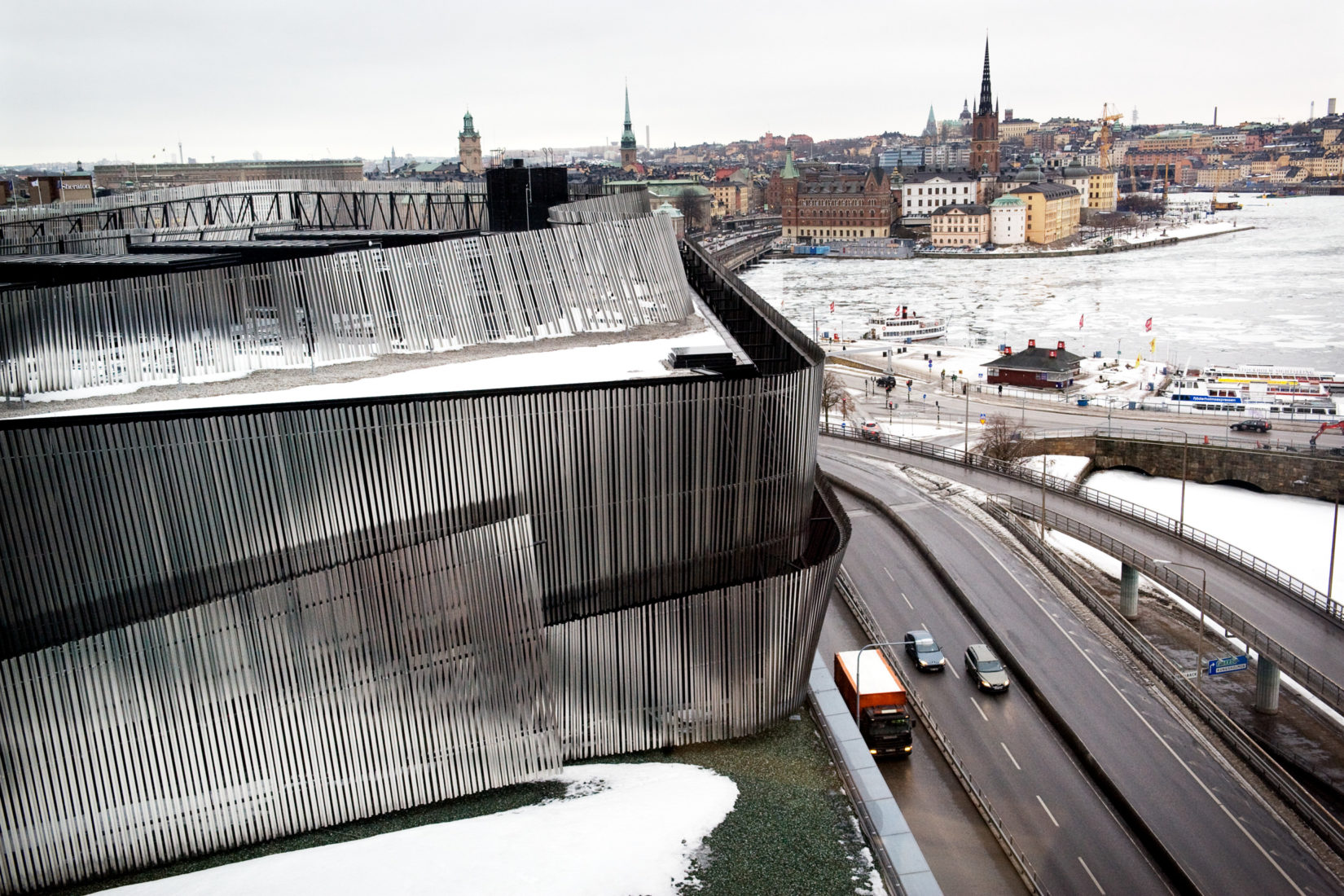 Stockholm Water Front building and the skyline behind as well as a part of the ice covered lake Mälaren in between. Photographer: Cecilia Larsson Lantz