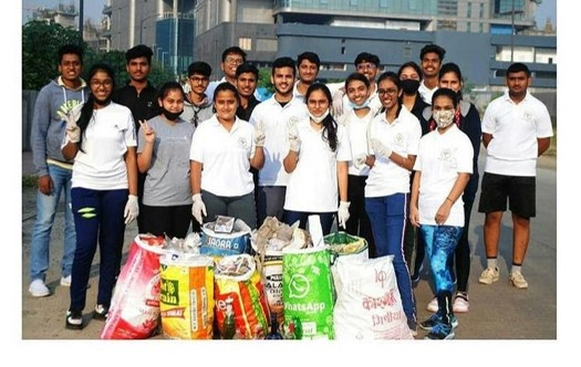 Sweden India Alumni network group picture with plastic bags