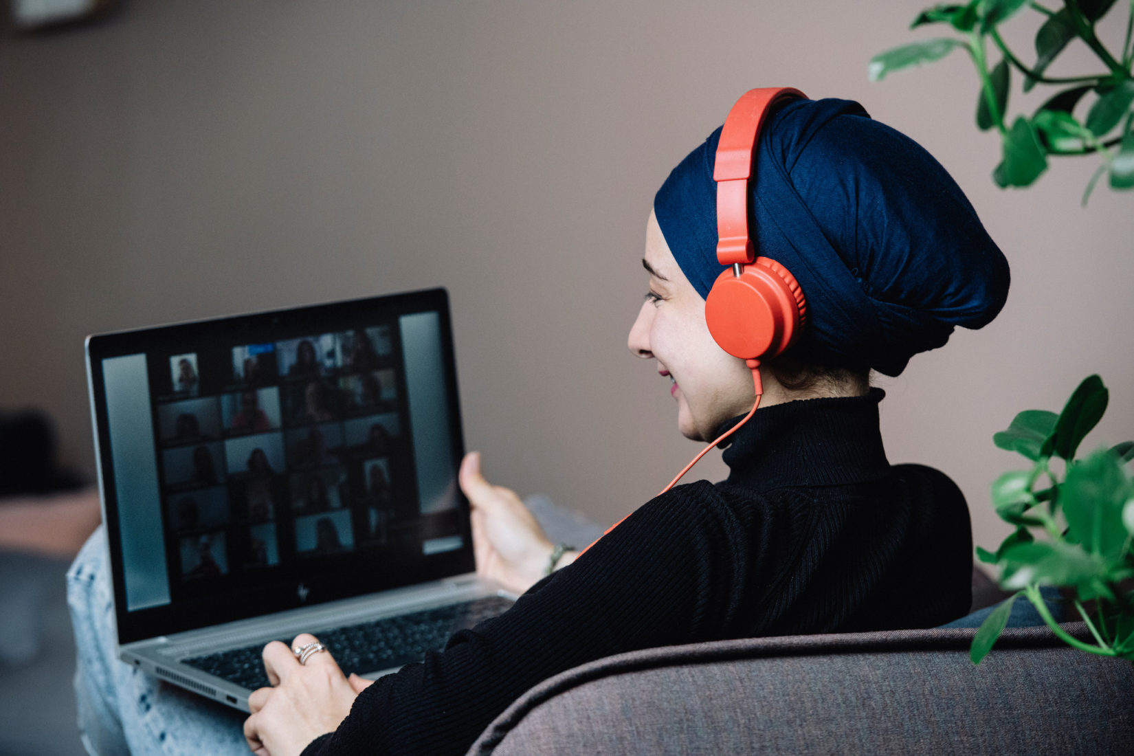 A woman connected to a online meeting.