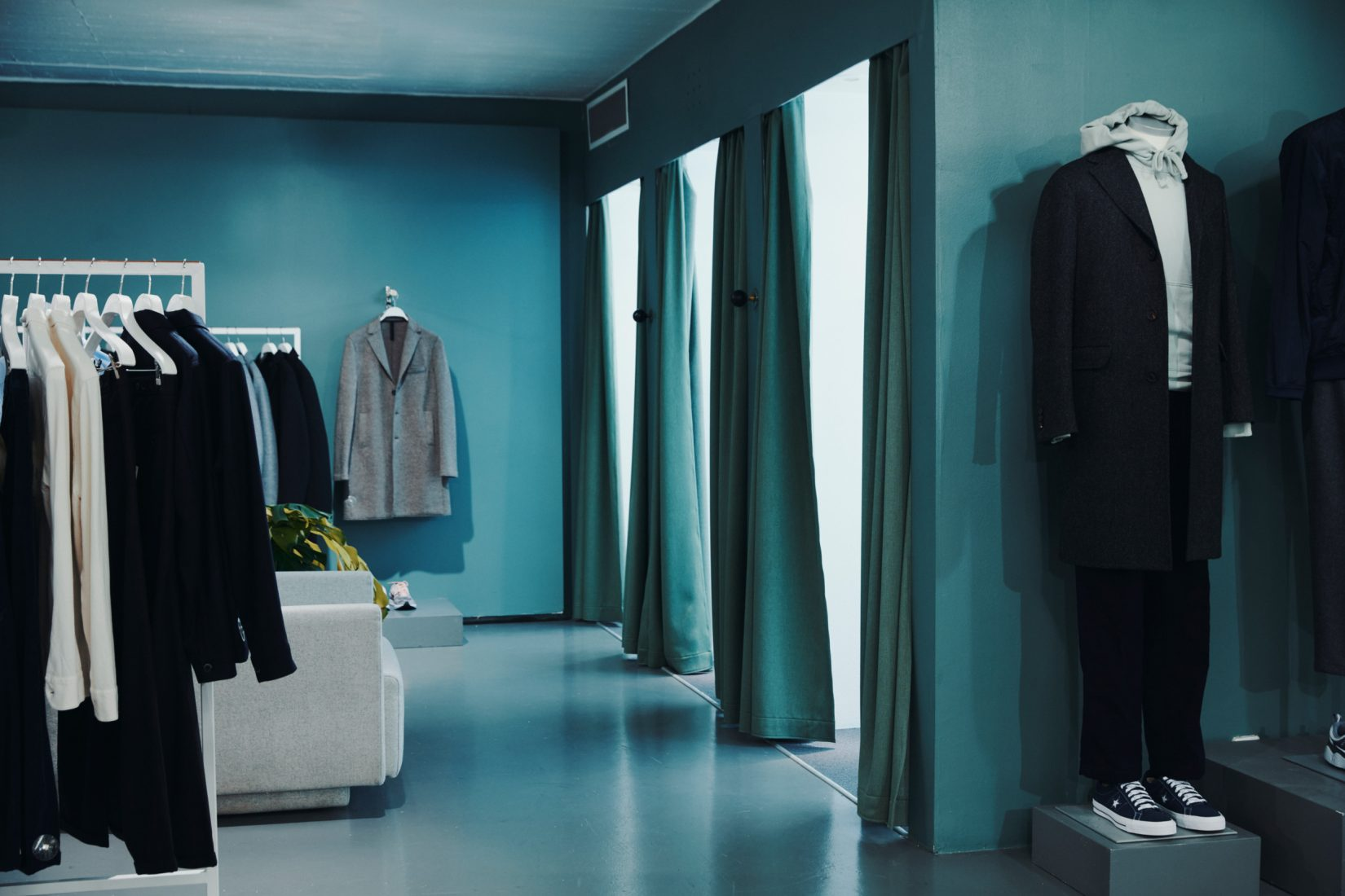 Inside an independent fashion store with colours in turquoise